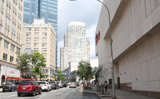 The Loew's Theatre and many other businesses were located along Main Street  between Court Street and South Lexington Avenue in 1968. Main Street is wider now, and the movie houses and small businesses were replaced by malls and office towers. In the background the old Home Savings Bank, now part of the White Plains City Center, survived.