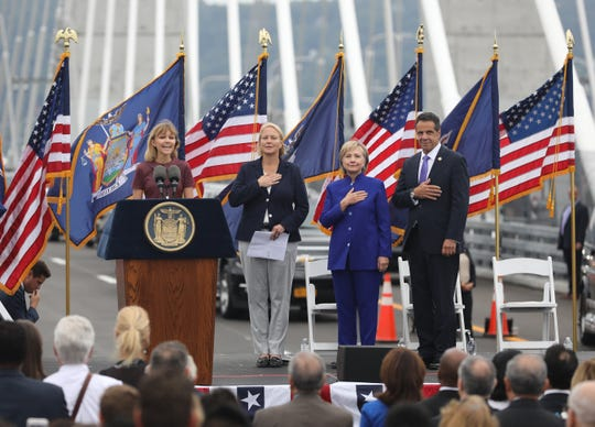 Singer Grace VanderWaal sings the National Anthem during the grand opening of the second span of the new Governor Mario M. Cuomo Bridge, Sept. 7, 2018. Also pictured are Joanne M. Mahoney, the Chair of the Thruway Board of Directors, Secretary Hillary Rodham Clinton and Governor Andrew Cuomo.