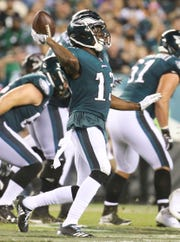 Eagles receiver Nelson Agholor lofts a pass to quarterback Nick Foles on a scoring drive in the third quarter of Philadelphia's 18-12 win against Atlanta in the NFL season-opener in Thursday Night Football at Lincoln Financial Field.