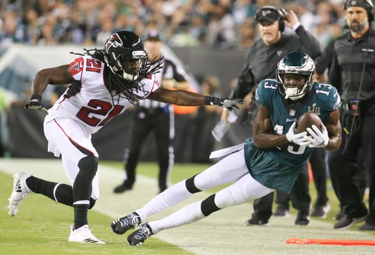 Atlanta's Desmond Trufant can't prevent Eagles receiver Nelson Agholor from making a reception in the second quarter of the NFL season-opener in Thursday Night Football at Lincoln Financial Field.