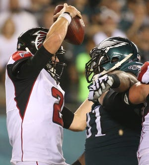 Atlanta quarterback Matt Ryan can't get away from Eagles defensive tackle Fletcher Cox in the fourth quarter of Philadelphia's 18-12 win in the NFL season-opener in Thursday Night Football at Lincoln Financial Field.