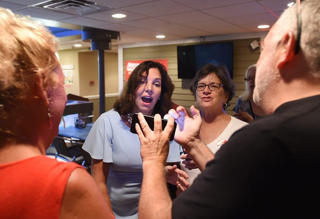 Kathy McGuiness celebrated her victory in the Democratic primary at Grotto's Pizza in downtown Rehoboth Beach.
