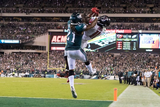 Eagles corner Ronald Darby (21) prevents Atlanta's Julio Jones (11) from scoring as time runs out in the Eagles' 18-12 win Thursday night at Lincoln FInacial Field.