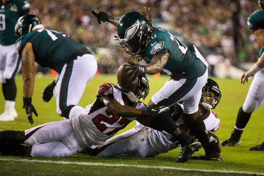 Eagles' Jay Ajayi (26) reaches over the goal line to score in the third quarter Thursday night at Lincoln Financial Field.