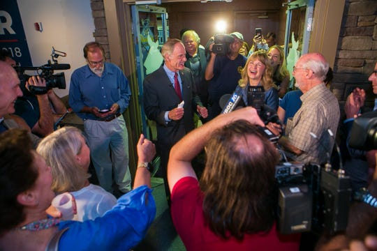 Incumbent U.S. Sen. Tom Carper and his wife Martha walk into Bluewinkle's Diamond Club at Frawley Stadium Thursday night in Wilmington to a cheering crowd of supportors as he gives a victory speech beating progressive political newcomer Kerri Evelyn Harris.