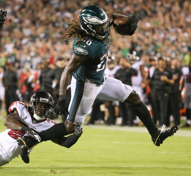 Eagles running back Jay Ajayi gets past Atlanta's Desmond Trufant for the go-ahead score in Philadelphia's 18-12 win in the NFL season-opener in Thursday Night Football at Lincoln Financial Field.