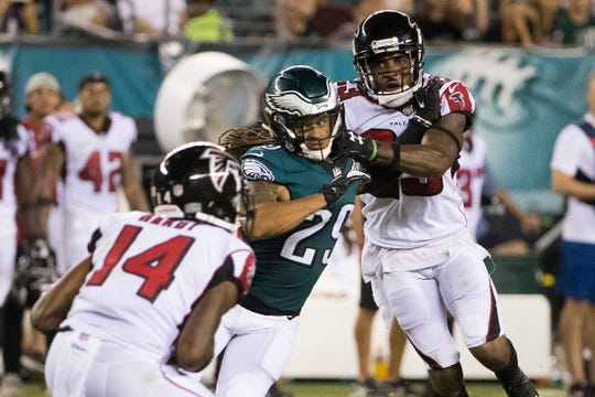 Eagles' Avonte Maddox, center, battles with Atlanta's Robert Alford, right, as Maddox tries to get to punt returner Justin Hardy Thursday night at Lincoln Financial Field.