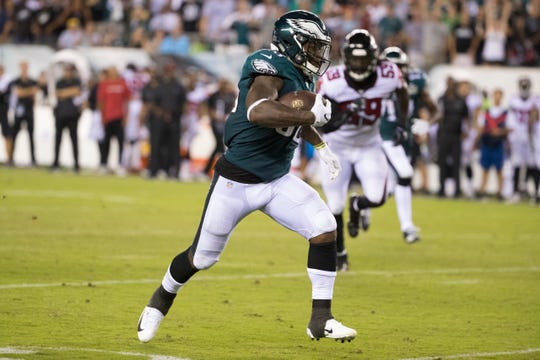 Eagles running back Corey Clement (30) breaks away from the Falcons defense Thursday night at Lincoln Financial Field. The Eagles defeated the Falcons 18-12.