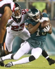 Atlanta's Robert Alford (left) can't stop a second quarter reception by Eagles receiver Nelson Agholor in the NFL season-opener in Thursday Night Football at Lincoln Financial Field.