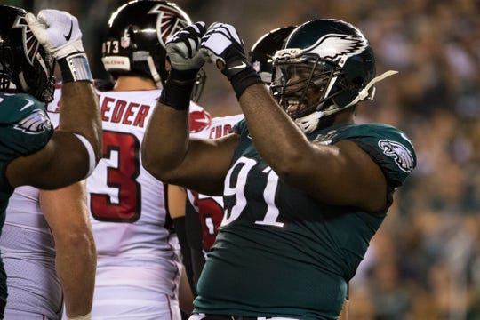 Eagles' Fletcher Cox (91) celebrates a big stop against the Falcons offense Thursday night at Lincoln Financial Field.