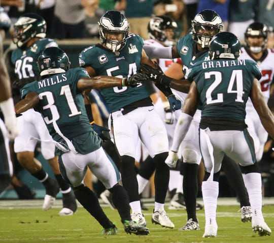 The Eagles, including Kamu Grugier-Hill (54), celebrate a fourth-and-goal stop in the first quarter against Atlanta in the NFL season opener on Thursday Night Football at Lincoln Financial Field.