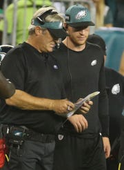 Eagle coach Doug Pederson has an assistant on the sideline in Carson Wentz in the third quarter of Philadelphia's 18-12 win in the NFL season-opener in Thursday Night Football at Lincoln Financial Field.