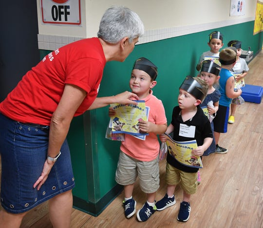 Ann Izzo of Upstart, shown in this Sept. 7, 2018, file photo, talks with a child about to graduate from the early reading program at Farris Early Childhood Center.