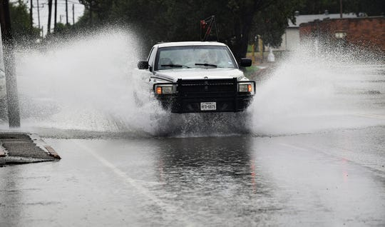 A truck plows through a flooded area of Old Jacksboro Highway near Scott Avenue Friday afternoon as heavy rain moved through  the Wichita Falls area.