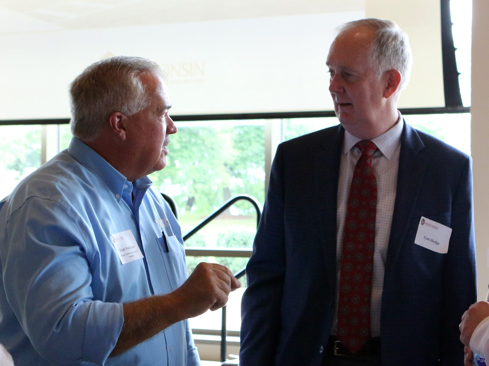 Matt Mathison (left), of Dairy Farmers of Wisconsin (retired) talks with Tom Hedge, senior vice president of Foth Production Solutions, LLC, during a celebration marking the launch of a $46 million construction and renovation project for UW-Madison's Babcock Hall Dairy Plant and Center for Dairy Research on Sept. 7.