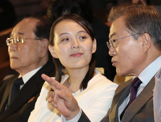 """In this Feb. 11, 2018, photo, South Korean President Moon Jae-in talks with Kim Yo-jong, North Korean leader Kim Jong Un's sister, during a performance of North Korea's Samjiyon Orchestra at the National Theater in Seoul, South Korea. A rare invitation to Pyongyang for South Korea's president marked Day Two of the North Korean Kim dynasty's southern road tour, part of an accelerating diplomatic thaw that included some Korean liquor over lunch and the shared joy of watching a """"unified"""" Korea team play hockey at the Olympics. At left is North Korea's nominal head of state Kim Yong Nam."""
