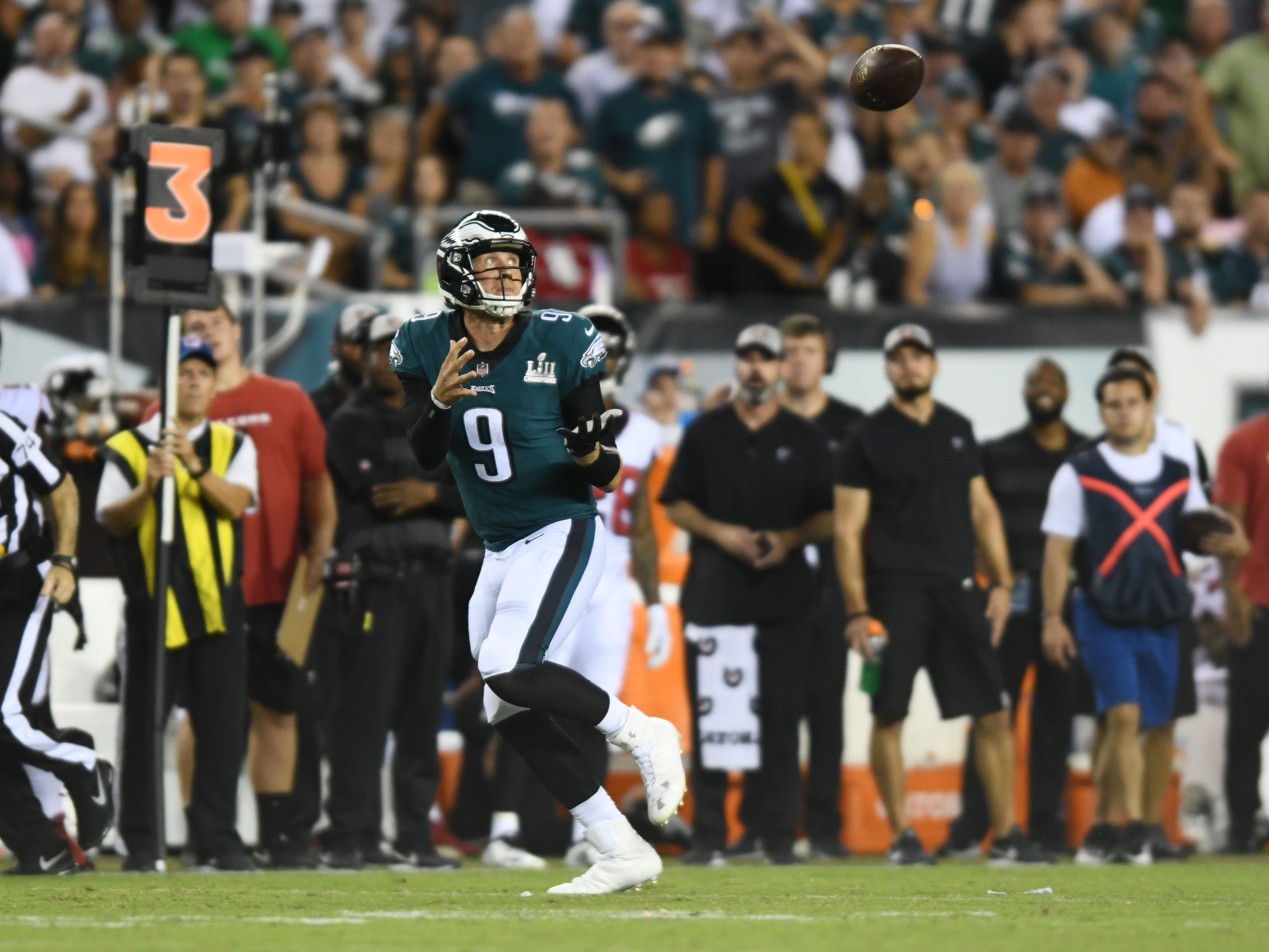 Philadelphia Eagles quarterback Nick Foles catches a pass from wide receiver Nelson Agholor in the third quarter against the Atlanta Falcons at Lincoln Financial Field.