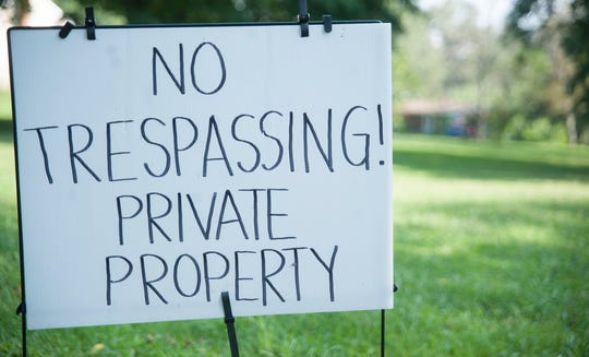 """A """"No Trespassing"""" sign sits at the Florence, New Jersey, home of Katelyn McClure and Mark D'Amico, whose home was searched by authorities Thursday, Sept. 6, 2018."""