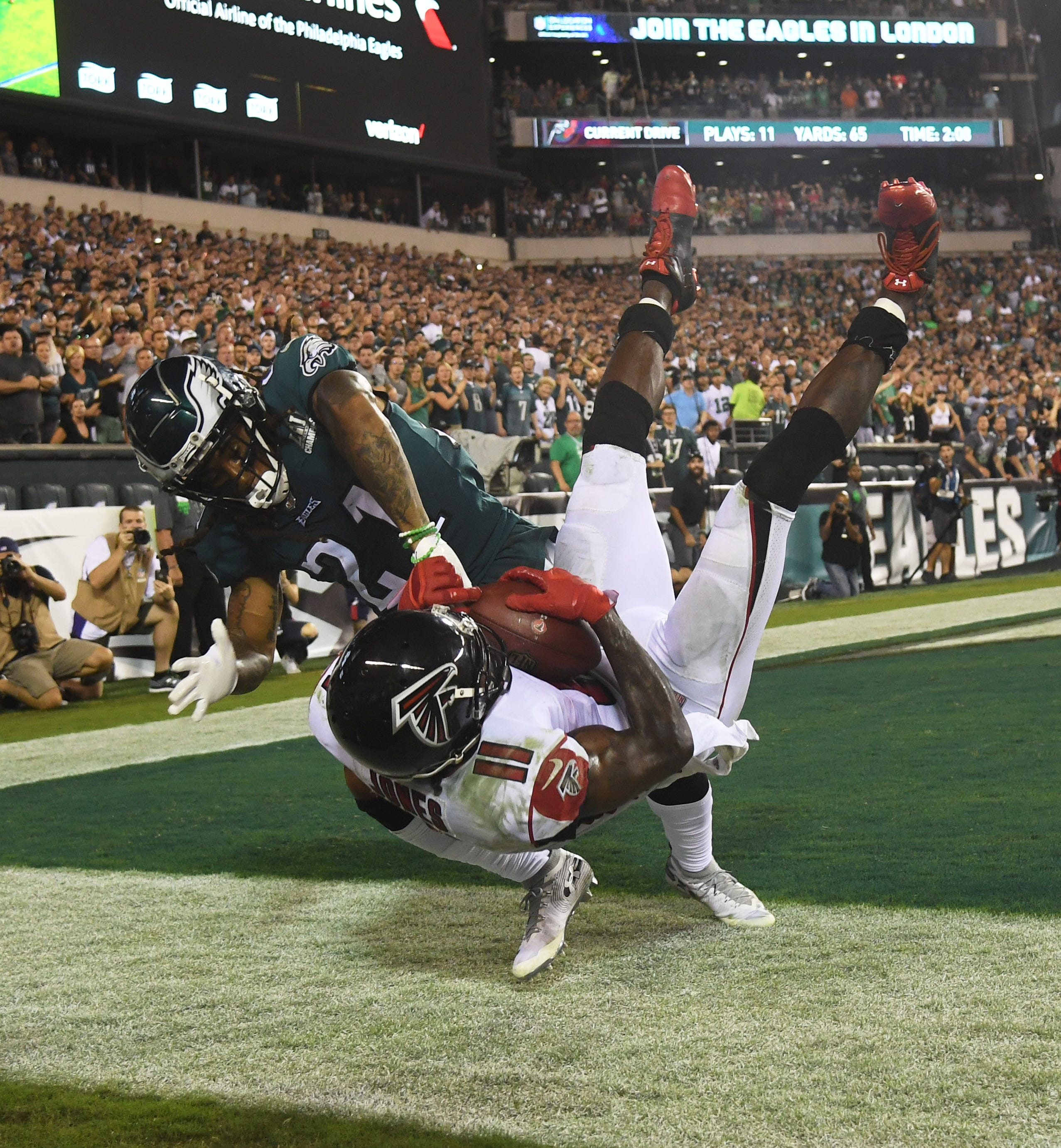 Philadelphia Eagles cornerback Ronald Darby pushes Atlanta Falcons wide receiver Julio Jones out of bounds on the final play of the Eagles - Packers QB Carted Off In Clash With Bears' 18-12 win at Lincoln Financial Field.
