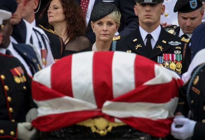 Cindy McCain looks on as a joint military service casket team carries the casket of the late Sen. John McCain following his funeral service at the Washington National Cathedral on Sept. 1, 2018, in Washington.