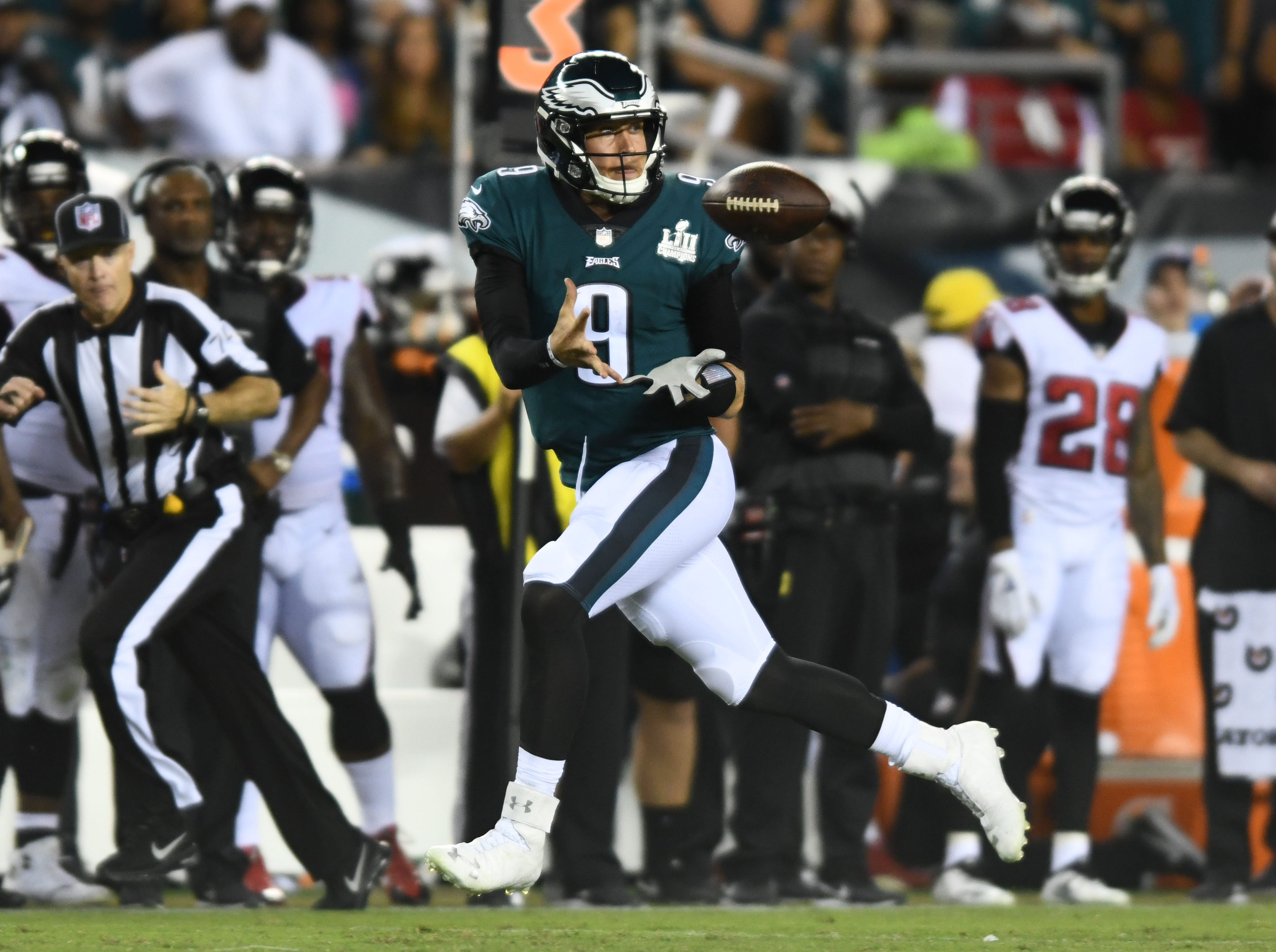 Nick Foles hauls in a pass from receiver Nelson Agholor in the third quarter.