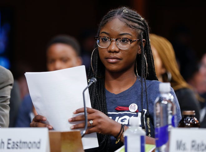 Aalayah Eastmond, a student at Marjory Stoneman Douglas High School, looks up after speaking before the Senate Judiciary Committee during the final stage of the confirmation hearings for President Donald Trump's Supreme Court nominee, Brett Kavanaugh, on Capitol Hill in Washington, Friday, Sept. 7, 2018.