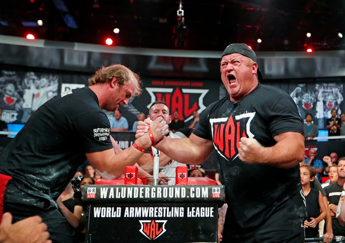 Jerry Cadorette, of Rehoboth, Mass., right, celebrates his win over Matt Mask, of Red Deer, Alberta, Canada, in the World Armwrestling League Championships in Atlanta on Sept. 5, 2018.