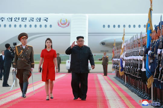 In this June 20 photo released by North Korea's official Korean Central News Agency shows North Korean leader Kim Jong Un and his wife Ri Sol Ju arriving at Pyongyang International Airport in Pyongyang, following their trip to Beijing.