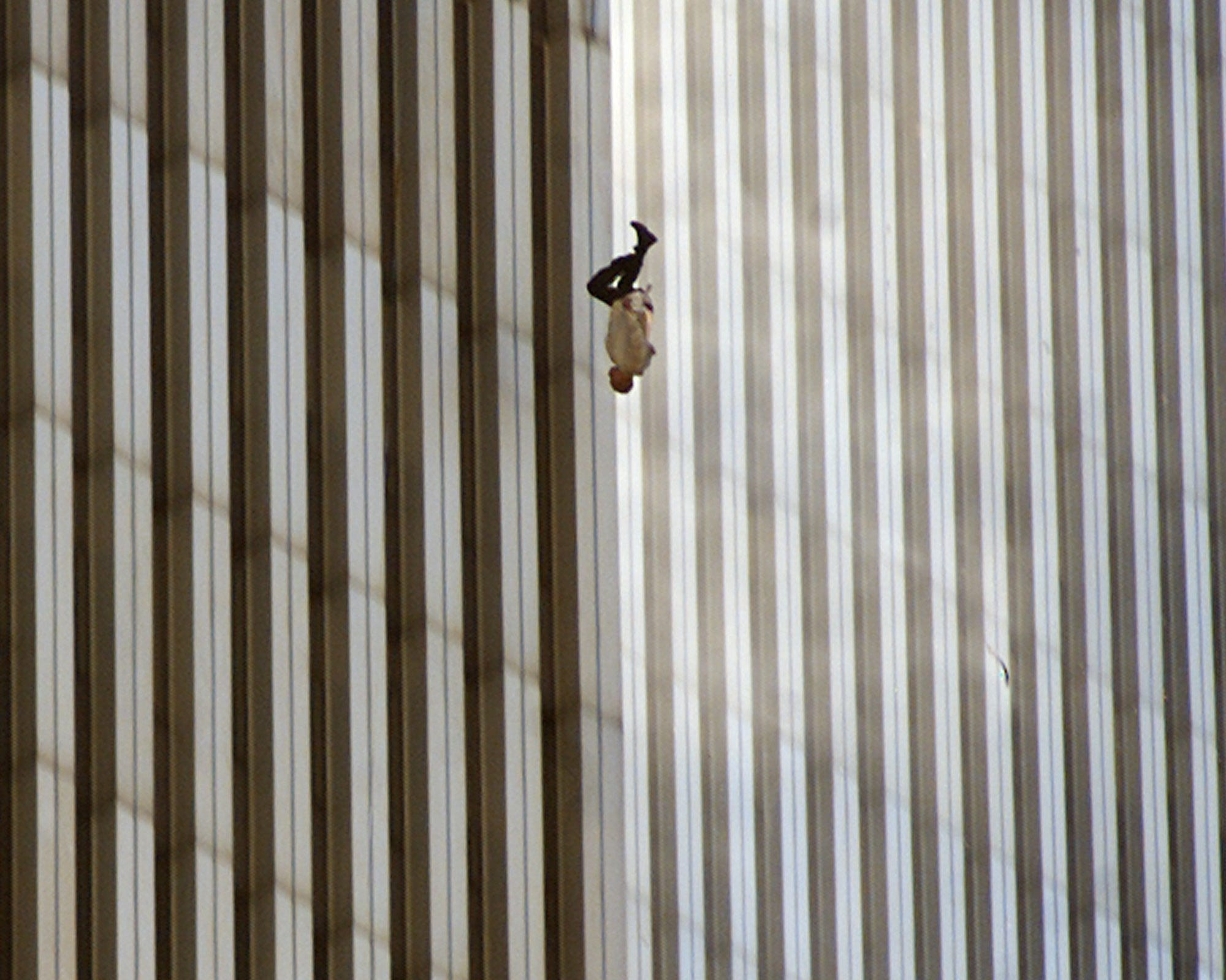 A person falls from the north tower of New York's World Trade Center.