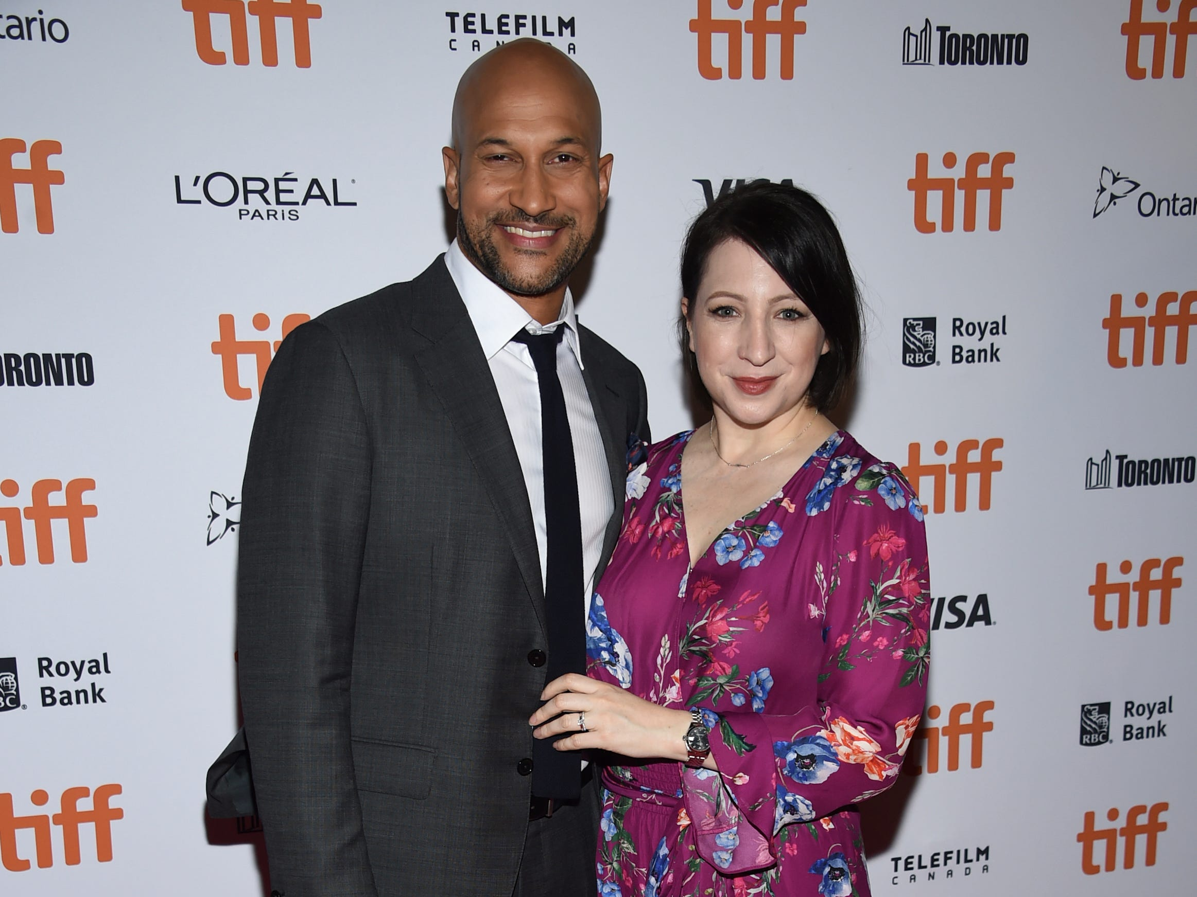 "Keegan-Michael Key and wife Elisa attend the premiere for ""The Predator"" at the Ryerson Theatre."