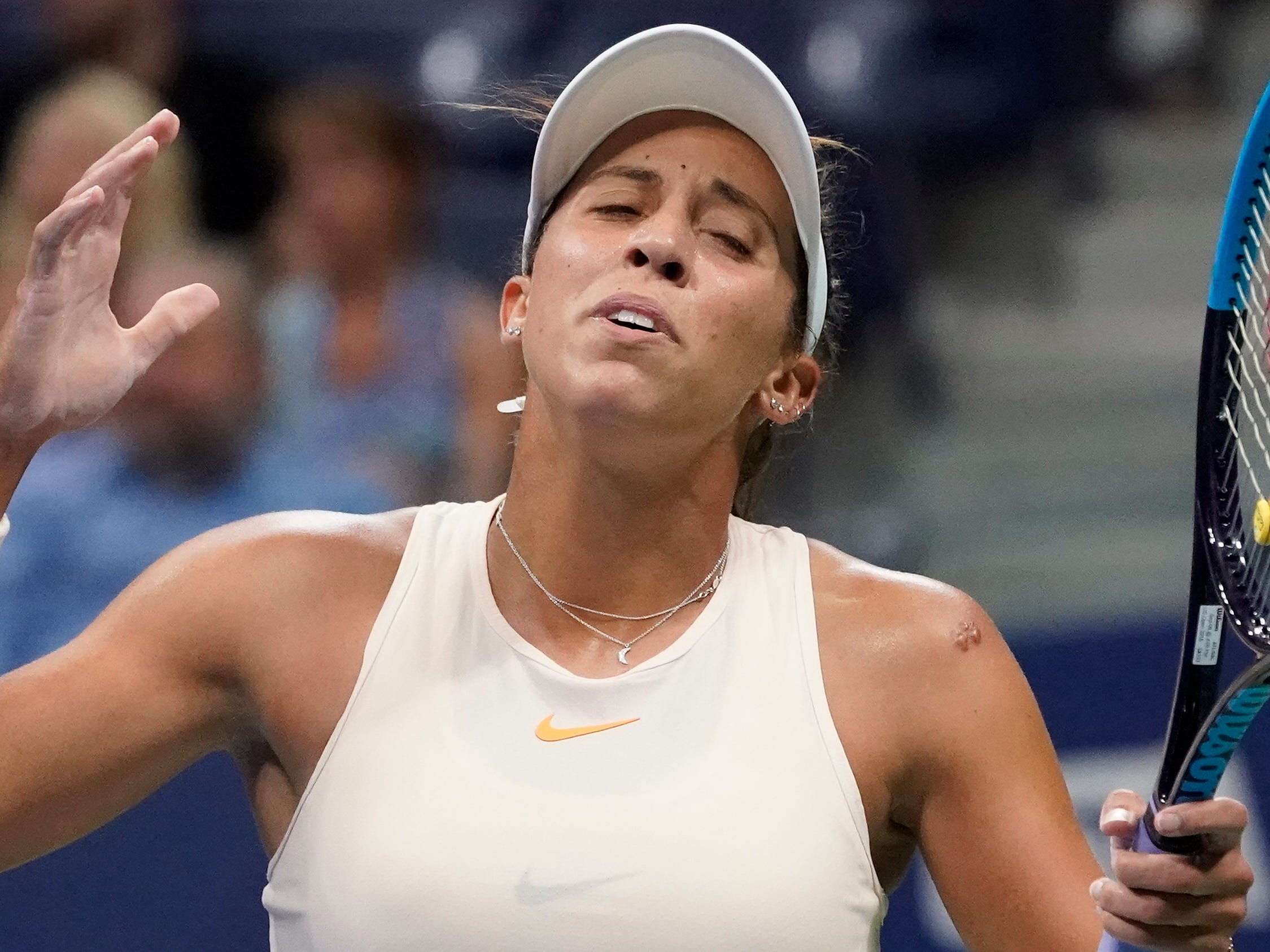 Madison Keys reacts after a big miss in the second set of her 6-2, 6-4 loss to Naomi Osaka in their semifinal match.