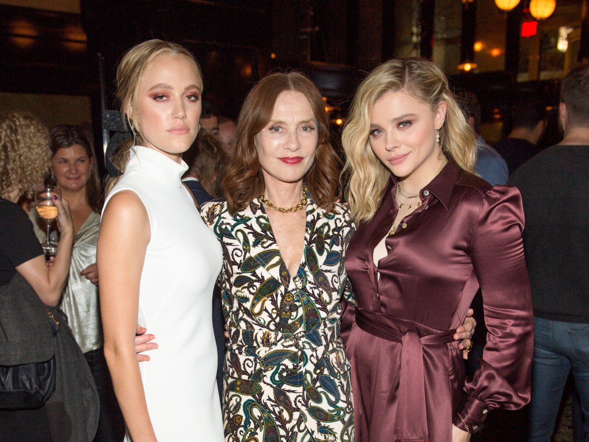 "Maika Monroe (far left), Isabelle Huppert and Chloe Grace Moretz attend the ""Greta"" premiere party at Weslodge."