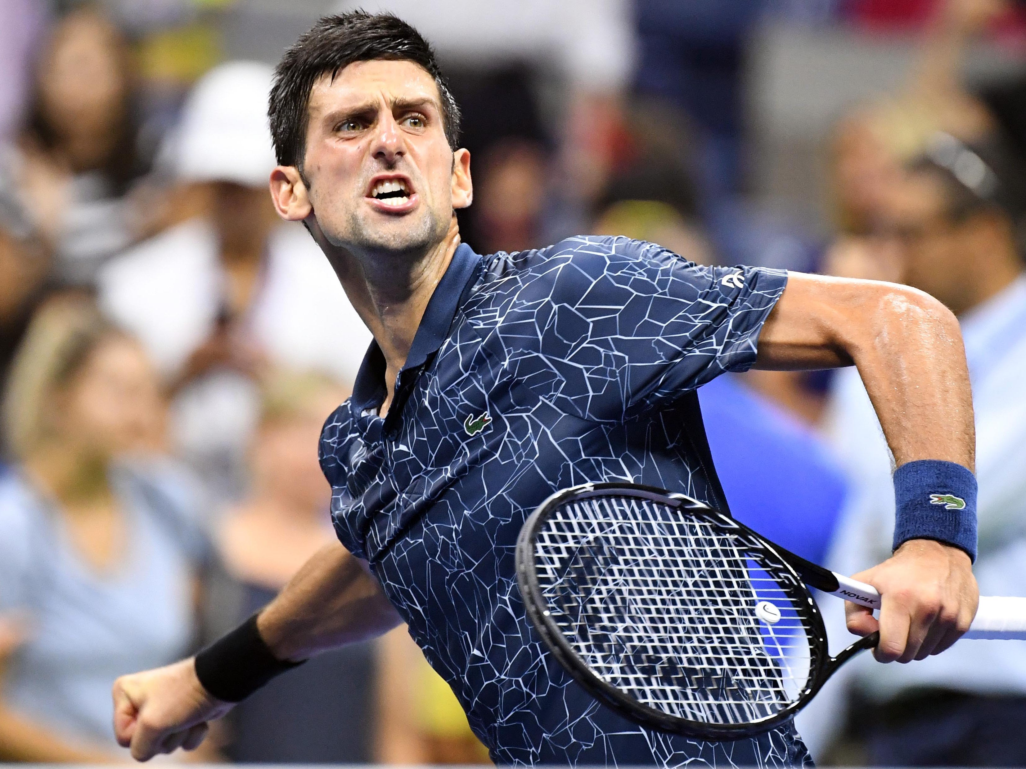Novak Djokovic celebrates his quarterfinal win over John Millman.