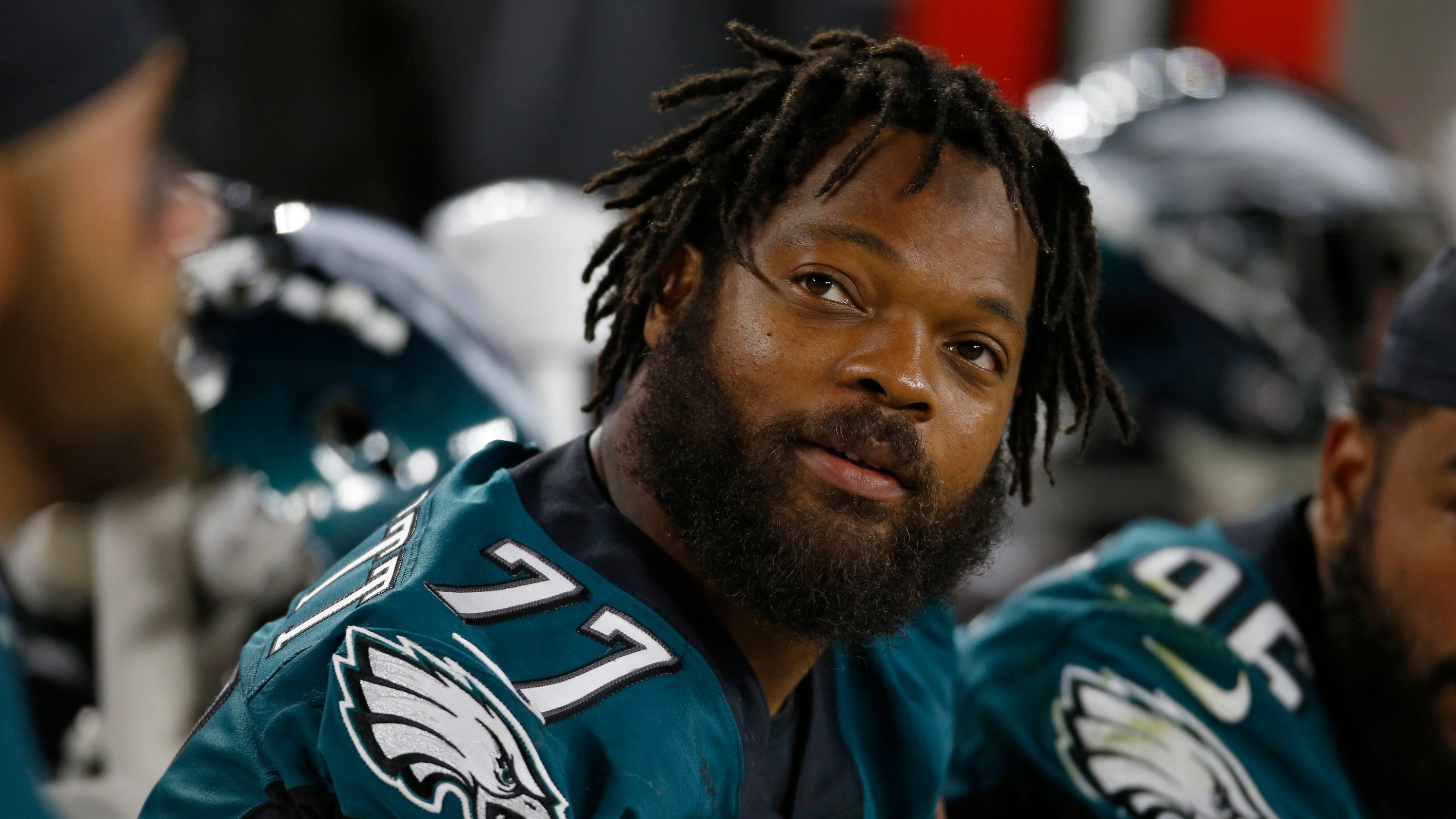 Eagles' Michael Bennett sits before end of national anthem in opener
