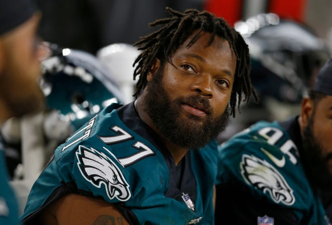 Philadelphia Eagles defensive end Michael Bennett watches during the second half of an NFL preseason football game against the Cleveland Browns, Thursday, Aug. 23, 2018, in Cleveland.