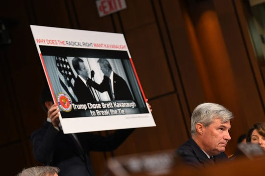 Sen. Sheldon Whitehouse, D-Rhode Island, was among the Democrats asking whether President Donald Trump chose Brett Kavanaugh for the Supreme Court to save him in a future criminal case.