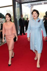 North Korean first lady Ri Sol-ju (L) walks with South Korean first lady Kim Jung-sook (R) at the Peace House in the Demilitarized Zone (DMZ) in the South Korean border village of Panmunjom on April 27.