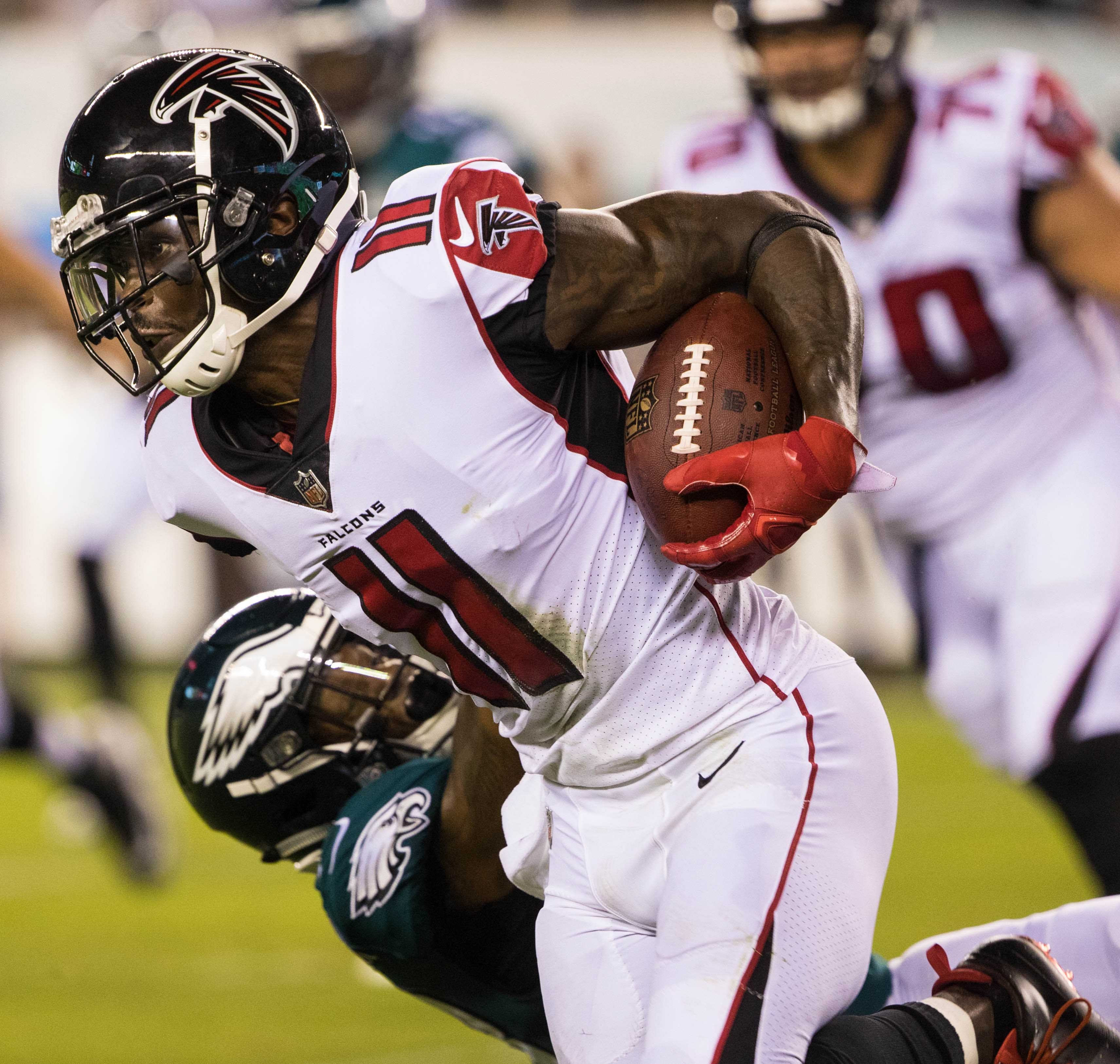 Atlanta Falcons wide receiver Julio Jones breaks the tackle attempt of Philadelphia Eagles defensive back Rodney McLeod during the first quarter at Lincoln Financial Field. - Packers QB Carted Off In Clash With Bears