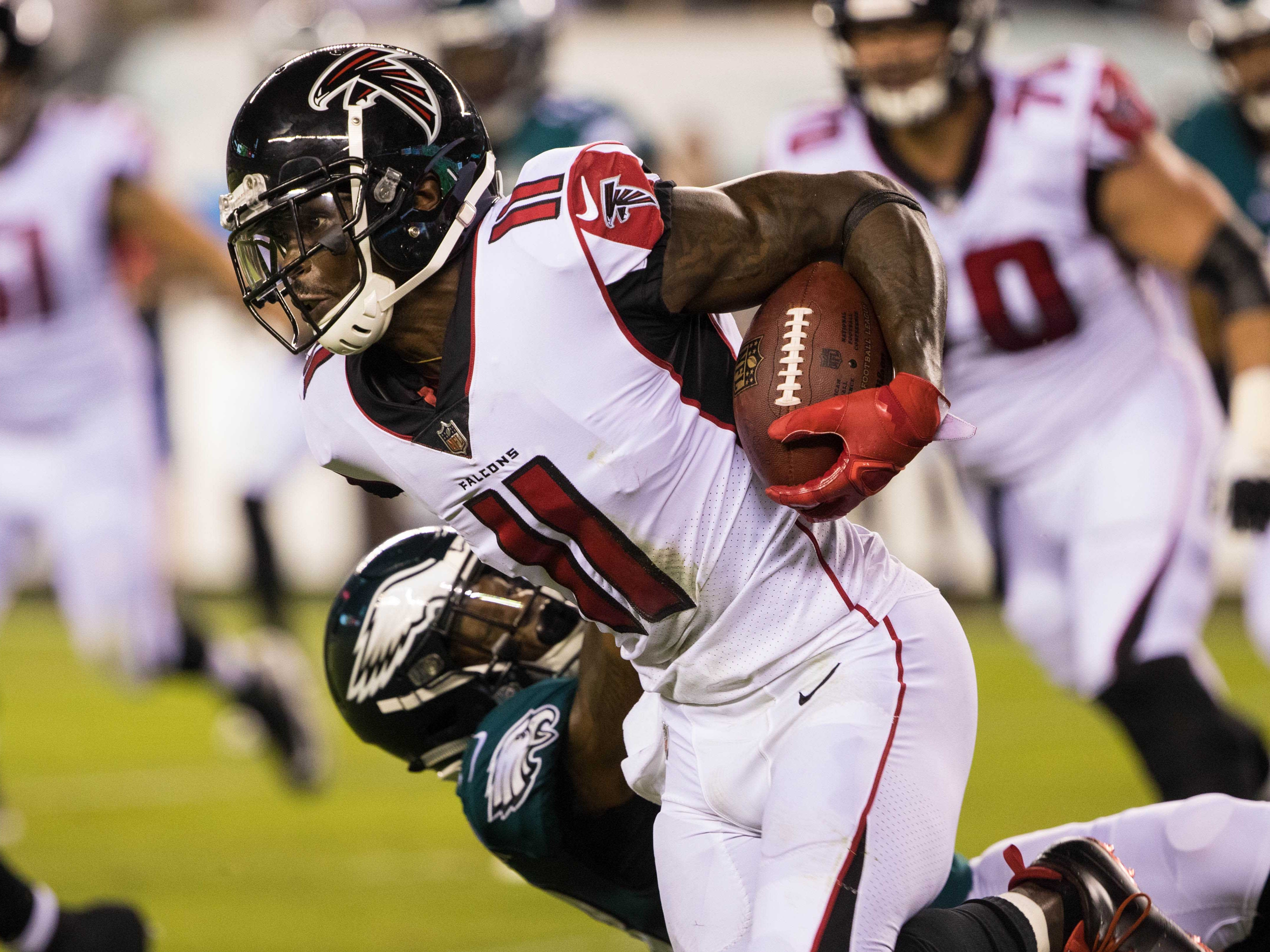 Atlanta Falcons wide receiver Julio Jones breaks the tackle attempt of Philadelphia Eagles defensive back Rodney McLeod during the first quarter at Lincoln Financial Field.