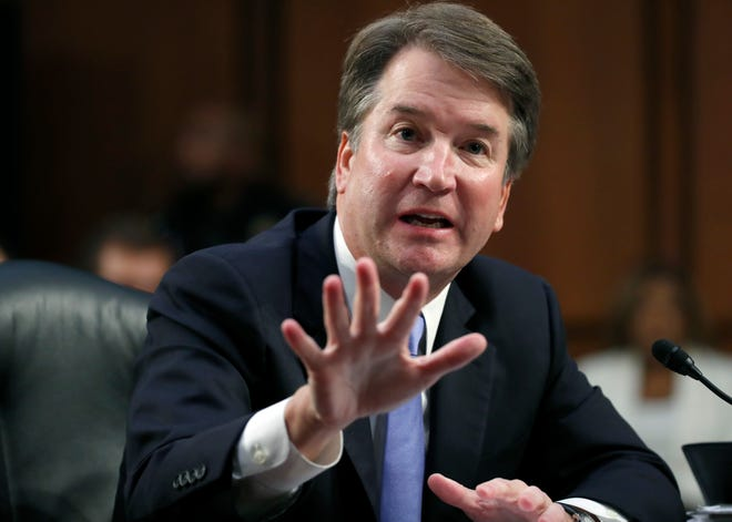 Supreme Court nominee Brett Kavanaugh responds to a question from Sen. Kamala Harris, D-California, during the third day of his confirmation hearing Thursday, Sept. 6.