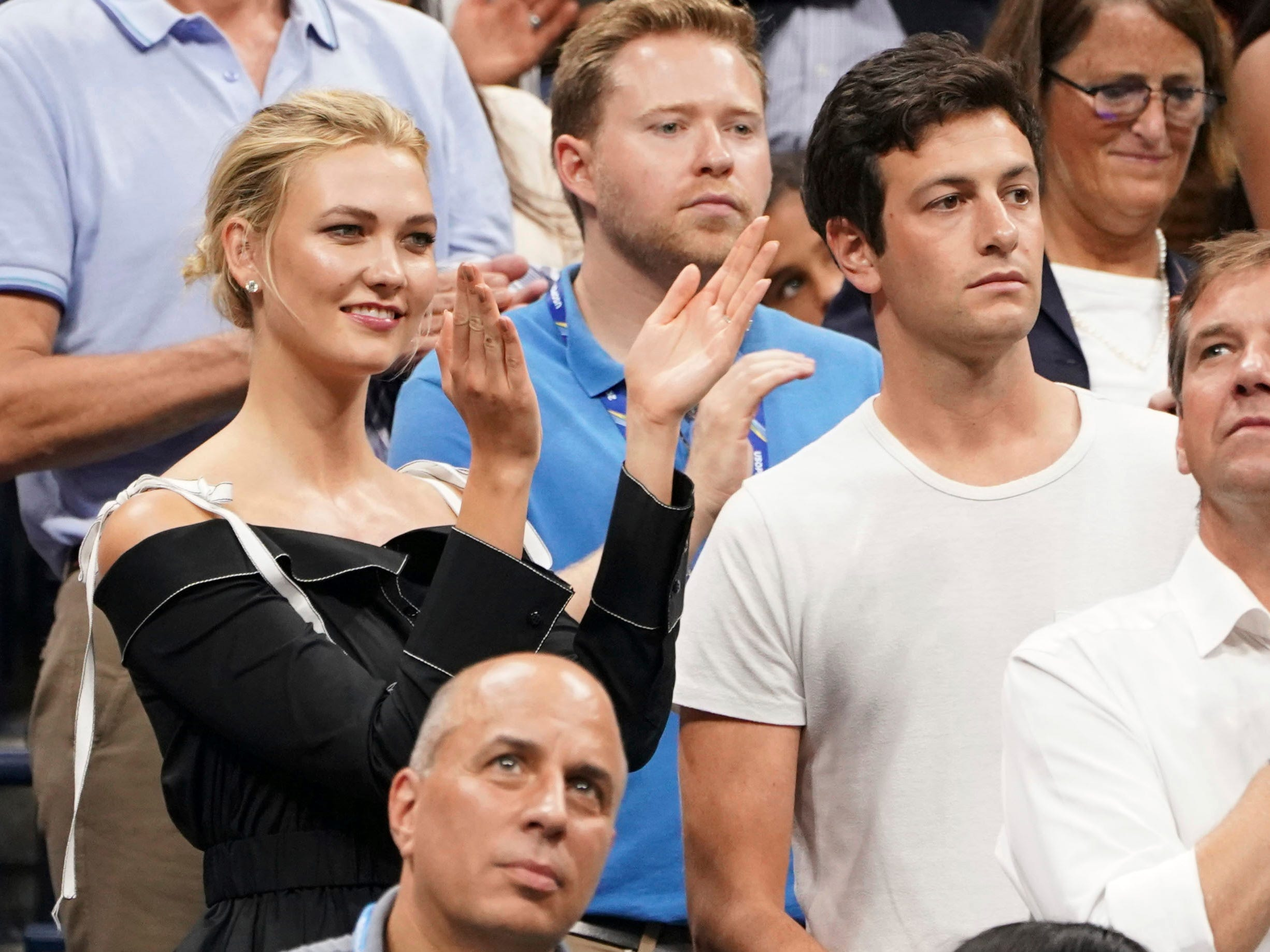 Model Karlie Kloss, left, and fiance Joshua Kushner, brother of Jared Kushner, attend the women's semifinals matches at Arthur Ashe Stadium.
