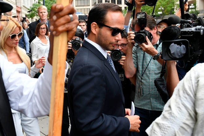 Foreign policy advisor to President Donald Trump's election campaign, George Papadopoulos and his wife Simona Mangiante Papadopoulos leave federal court after his sentencing.