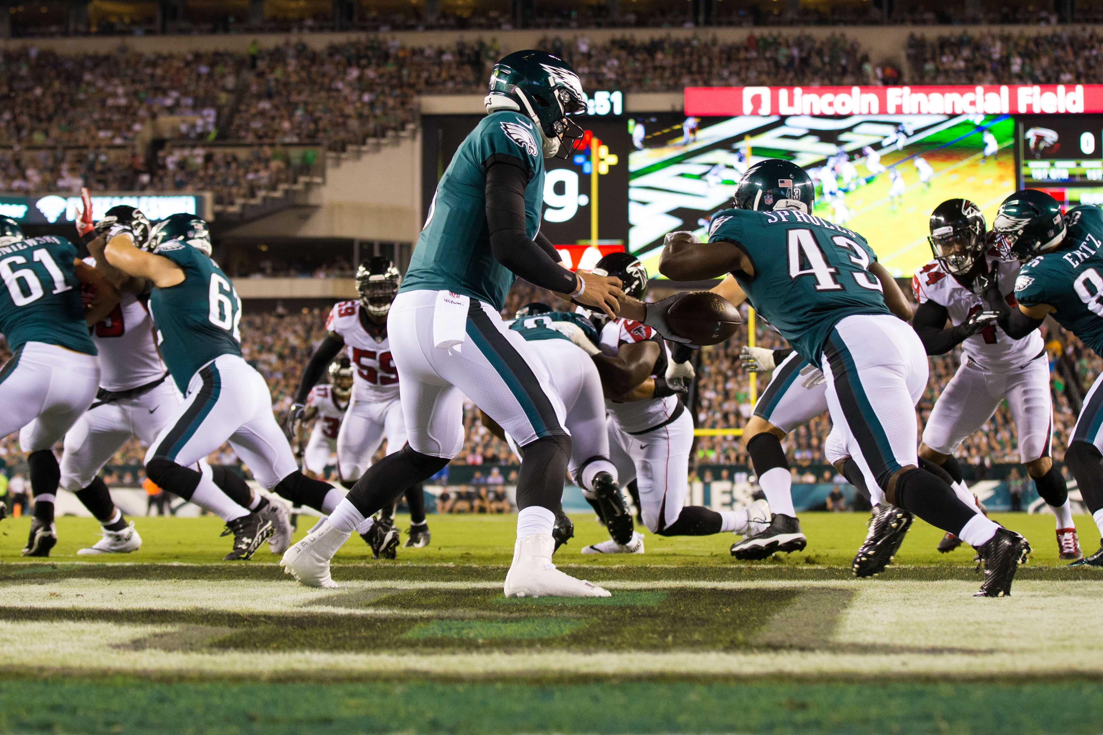 Philadelphia Eagles quarterback Nick Foles hands off to running back Darren Sproles during the first quarter against the Atlanta Falcons at Lincoln Financial Field. - Packers QB Carted Off In Clash With Bears