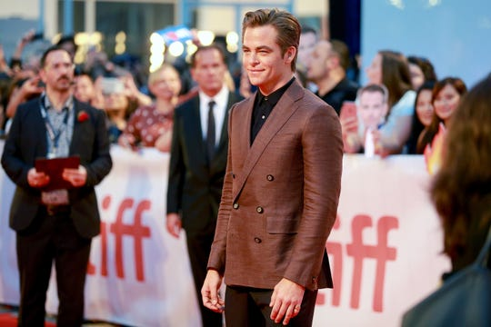 """In real life, Chris Pine's hair remains glorious. He attended """"Outlaw King's opening night gala at the Toronto International Film Festival Thursday."""