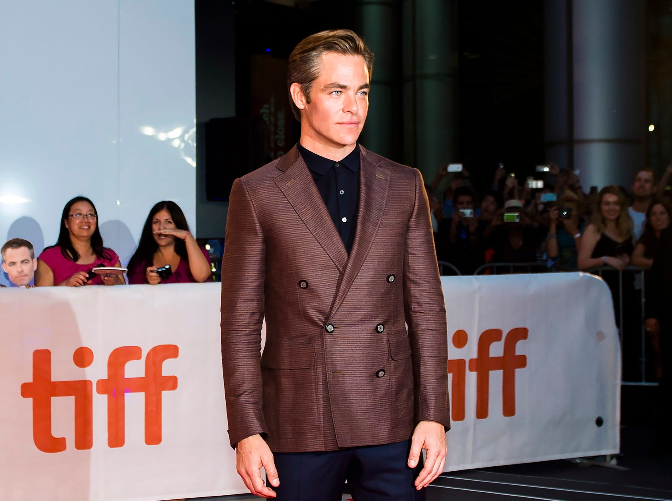"Actor Chris Pine poses for photographs on the red carpet after arriving for the new movie ""Outlaw King"" during the 2018 Toronto International Film Festival in Toronto on Thursday, Sept. 6, 2018. (Nathan Denette/The Canadian Press via AP) ORG XMIT: NSD109"