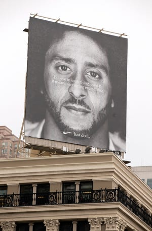 "Colin Kaepernick's image appears in San Francisco and elsewhere as part of Nike's ad campaign celebrating the 30th anniversary of the ""Just Do It"" slogan."