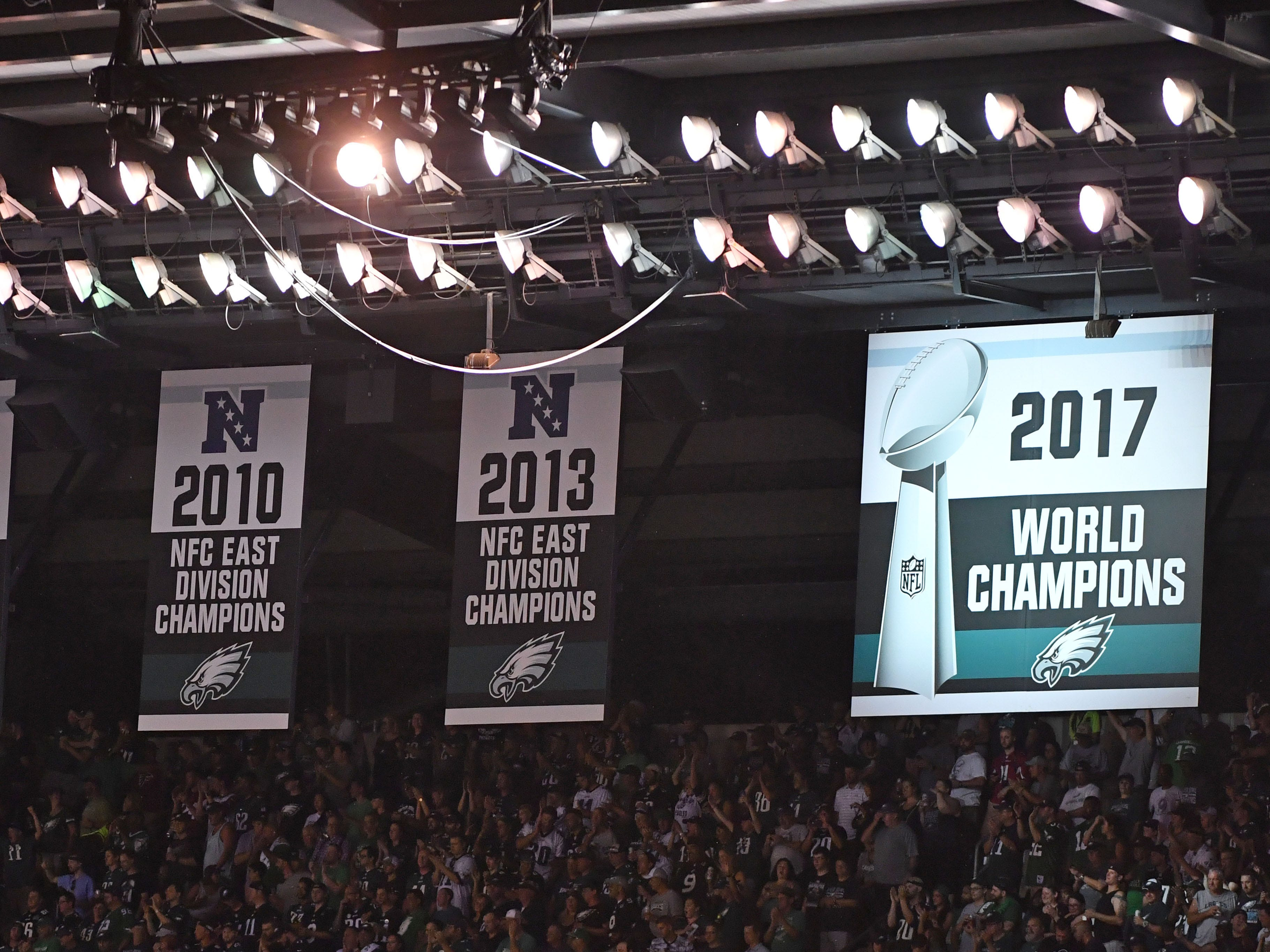 The Philadelphia Eagles unveil their Super Bowl LII champions banner before the 2018 season opener against the Atlanta Falcons at Lincoln Financial Field.
