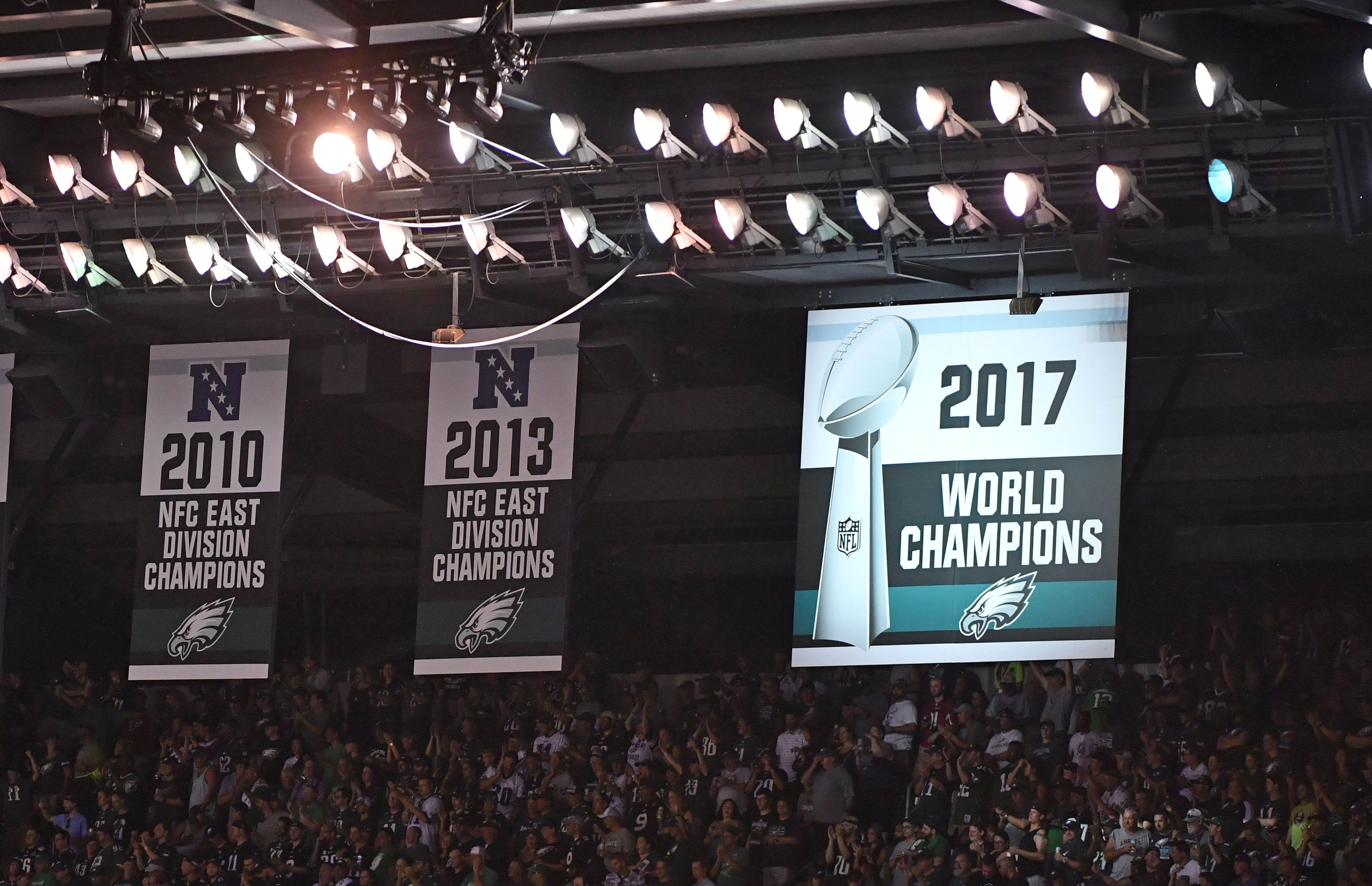 The Philadelphia Eagles unveil their Super Bowl LII champions banner before the 2018 season opener against the Atlanta Falcons at Lincoln Financial Field. - Packers QB Carted Off In Clash With Bears