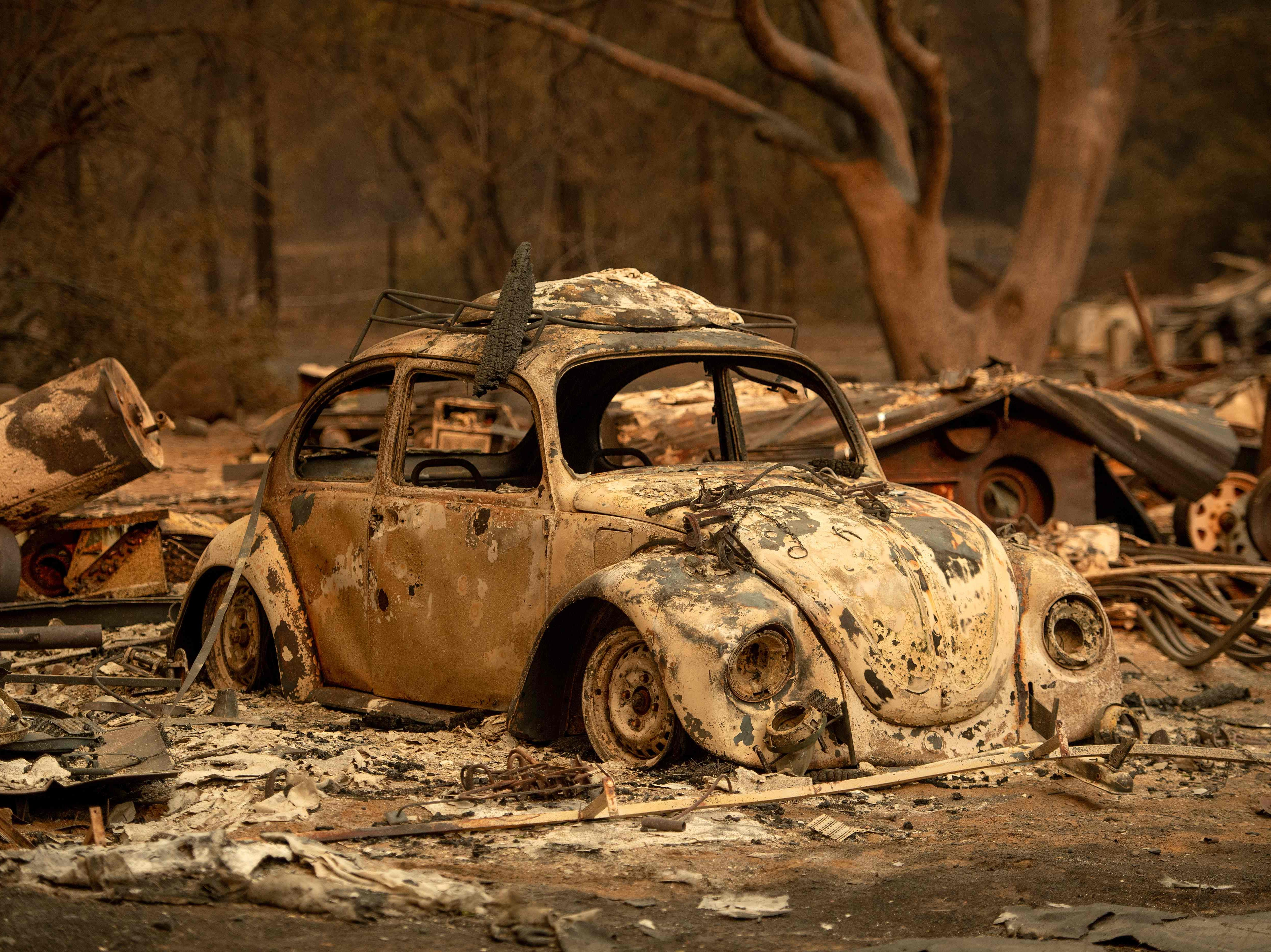 A burned out vehicle rests after the Delta Fire tore through a neighborhood in Lamoine, California in the Shasta Trinity National Forest on September 6, 2018.