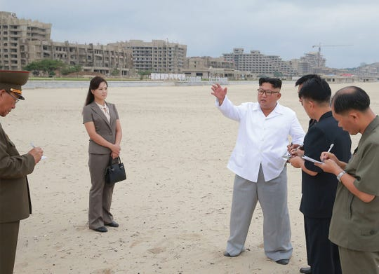 This undated picture released by North Korea's official Korean Central News Agency on August 17, 2018 shows North Korean leader Kim Jong-un and his wife Ri Sol-ju inspecting the construction site of the Wonsan-Kalma coastal tourist area in Kangwon Province.
